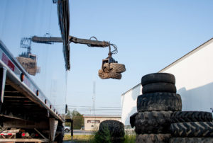 crane arm loading tires