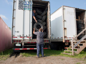 Filling up a tba tractor trailer with tires