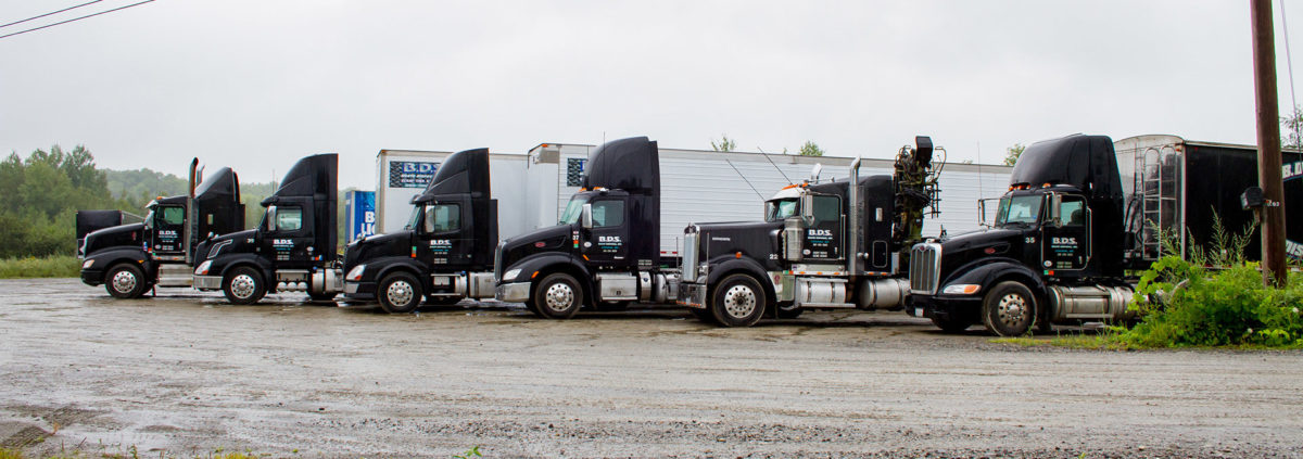 fleet of tba tractor trailer trucks